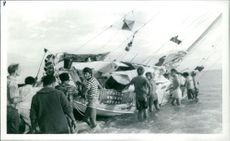 People trying to untilt a sailing boat.  Taken - Circa 1973