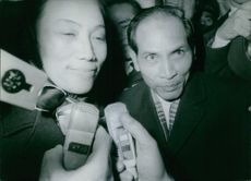 Nguyễn Thị Bình (left) facing the journalist after the conference. 1968.