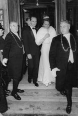 Princess Irene and Carlos Hugo getting out of a building with their body guards, 1966.