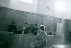 People siting in the courtroom.