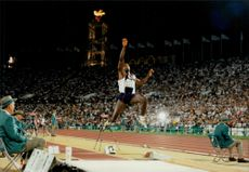 Carl Lewis took gold in the long jump during the Olympics.