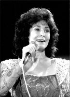 Country singer Loretta Lynn performs on stage.