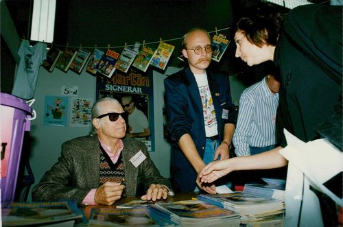 American cartoonist Don Martin signs during the Book Fair.
