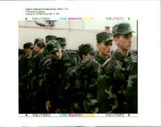 Bosnian Army recruits line up to sign their oath.