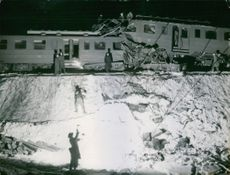 Rail disaster at Vallentuna. The picture shows the collided tags attendant high on the embankment.  1948