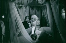 France Anglade sitting nube with a man on a bed.1967