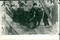 Rescue workers freeing a guest from the debris.
