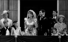 Sarah Ferguson and Prince Andrew listen to the spectators' request of a kiss from the balcony at Buckingham Palace on their wedding day
