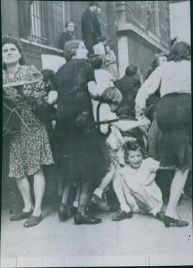 People looking up and running, while a child girl fell down and crying.