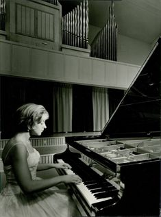 Inger Wikstrom playing on piano.