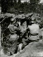 Soldiers aiming at their target.