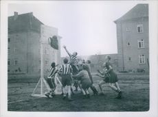Occupation troops playing basketball.