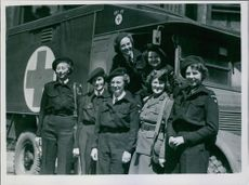 A group of Danish women drivers who are taking the ambulances to Denmark.