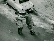 Mehdi Ben Barka fighting with man.
