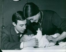 Micaela Flores Amaya, La Chunga and José Luis Gonzalvo playing with their baby. 1962