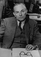 Dr. Hans Ehard at his desk in his office.