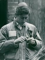 Prince Charles of Wales fishes at River Frome.