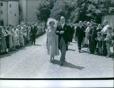 Guests walking at Württemberg wedding surrounded by people.