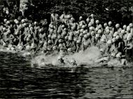 Stockholm Triad. The start goes for the swimming and the triathlets are thrown into the water