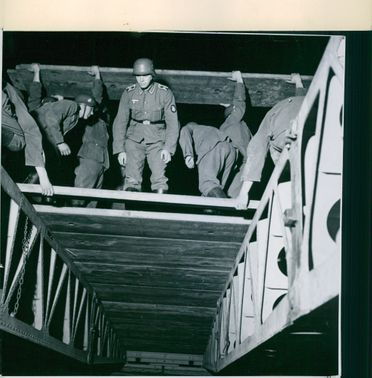 Troops checking on the bridge.