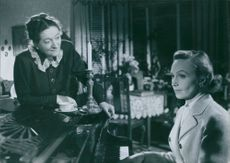 """Inga Tidblad and Hjördis Petterson in a scene from a 1951 Swedish drama film, """"Divorced""""."""