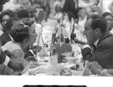 Aga Khan IV with a woman in party.