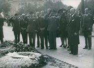 Soldier saluting and showing respects to the martyrs grave. 1946.