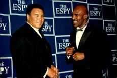 Muhammad Ali and heavyweight boxer Evander Holyfield in conversation at the ESPY Awards.