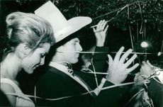 Sylvia Casablancas with a man wearing hat.