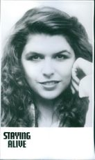 "A photo of Finola Hughes in a film ""Staying Alive""."