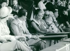 Albert II of Belgium with his wife Queen Paola of Belgium and child in stadium.