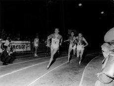 Runner athletes are having a close race.  - 1965