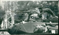 A Government tank in action against revel forces during Vietnam War