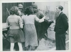 Two German women making a complaint to the U.S. soldiers, the accused German standing right next to them.