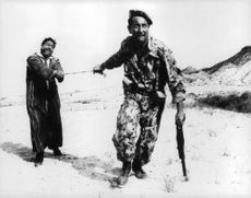 One of the scenes in the movie that armed man pulling a rope tied to the hands of his captive in Algeria.
