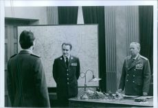 Picture of two high ranks official are talking to each other.