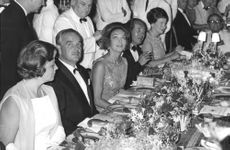 Rainer III, Prince of Monaco at dining table.