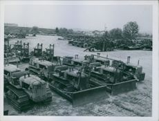Rebuilt American bulldozers are lined up in a storage yard of the 491st engineer based equipment company  at Choisy-Le-Roi just outside Paris, France.