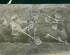 People digging, face covered with face masks.