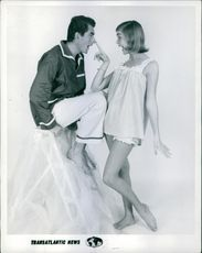 Michael Bentley's presents makes for an unusually lively fashion photo with Jackie Cahill, Britain's top teenage model.