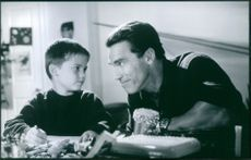 "Jake Lloyd and Arnold Schwarzenegger in a scene from the film ""Jingle All the Way""."
