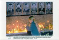 A girl lights a candle for the firefighters who fought and killed in the Chernobyl accident.