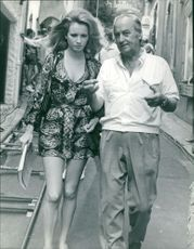 Geneviève Gilles discussion in street while walking.