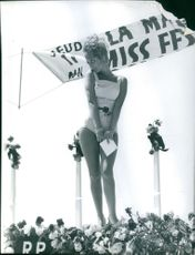 Miss Festival in Cannes posing on stage in a bathing suit.  - May 1961