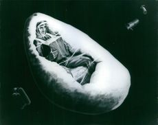 A drawing of a man floating in space.