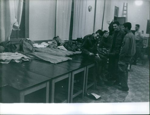 Soldiers resting and bonding inside a building in Algeria.  - 1960