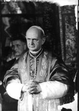 Pope Paul VI preying.