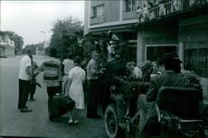 People being shifted by vehicle.