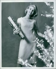 Woman posing with gift.