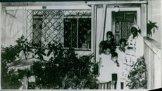Carolina Maria de Jesus standing outside the house with her children. Photo taken on April 30, 1962.